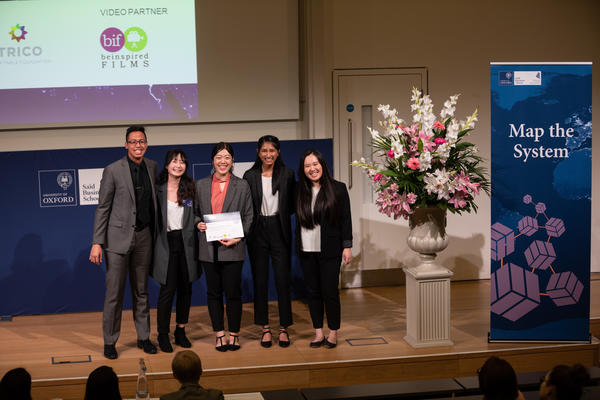 Bridging the Gap, Simon Fraser University team holding Map the System 2018 prize award